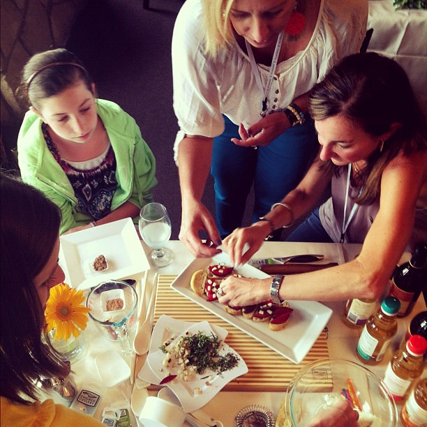 Making crostini with @foodiecrush @twopeasandpod and @alisonlewis. #evoconf @nakanosplash