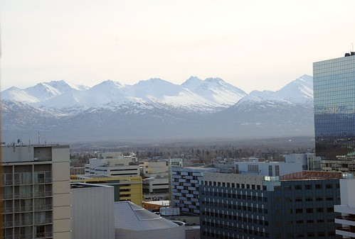 Chugach Range under snow, buildings, skyscraper reflecting the mountains, Anchorage, Alaska, USA by Wonderlane