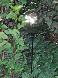 Plastic gazing globe on stake in foliage