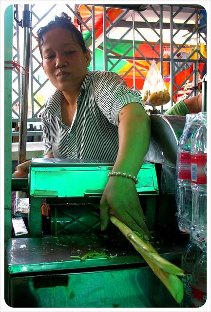 phnom penh central market sugar cane lady
