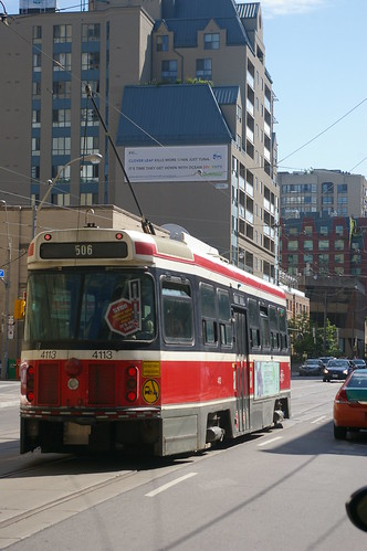 12-193 Toronto Transit CLRV road car No. 4113 heads through Church/Yonge towards Main Square Station on Route 506