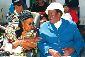 Former Zimbabwe Vice President Simon Muzenda's widow Amai Maud Muzenda (right) talks to Cde Emmy Ncube during a meeting of female ex-combatants in Harare last week. by Pan-African News Wire File Photos