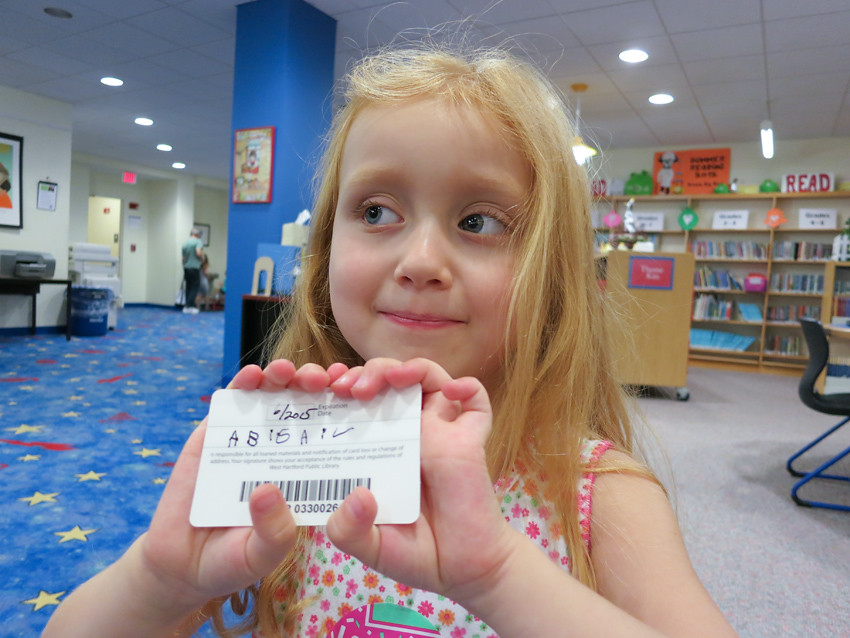 library card holding