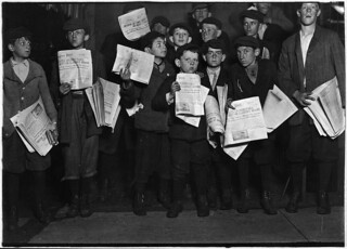 After midnight selling extras. There were many young boys selling very late these nights. Washington, D.C, April 1912