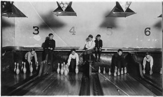 Photo of boys working in Arcade Bowling Alley. Photo taken late at night. The boys work until midnight and later. Trenton, N.J., December 1909