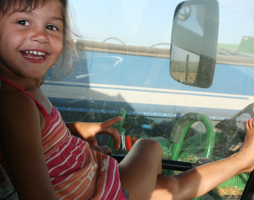 Kaidence gets comfortable on her combine ride