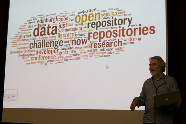 Image of the Closing Session at OR2012 with Wordle by Adam Field shown in the background.