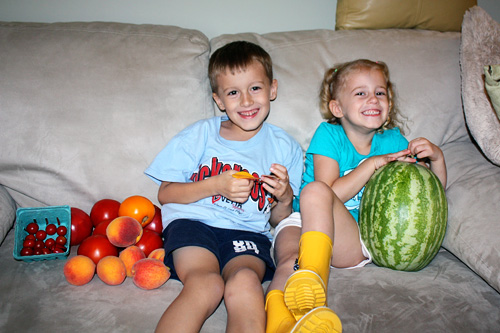 Kids-on-couch-with-market-stuff