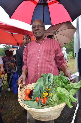 Avon Standard shows the produce grown in his season high tunnel in Cleveland.