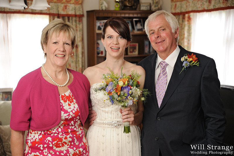 Portrait of the bride with the mother of the bride and the father of the bride