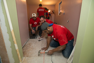 Greater NY volunteers Robert Villanueva, Mike Fleet and Darius Alemzadeh install pergo flooring