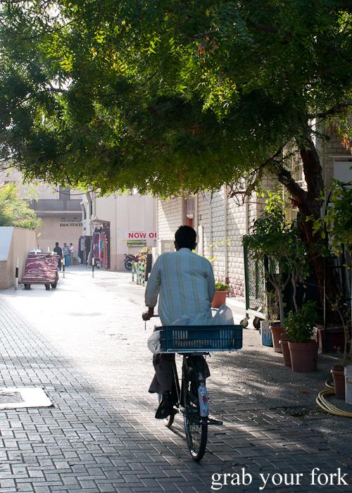 Cyclist in Meena Bazaar, Dubai