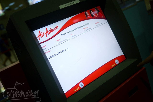 confirm your itinerary at Air Asia Self Check In Kiosk