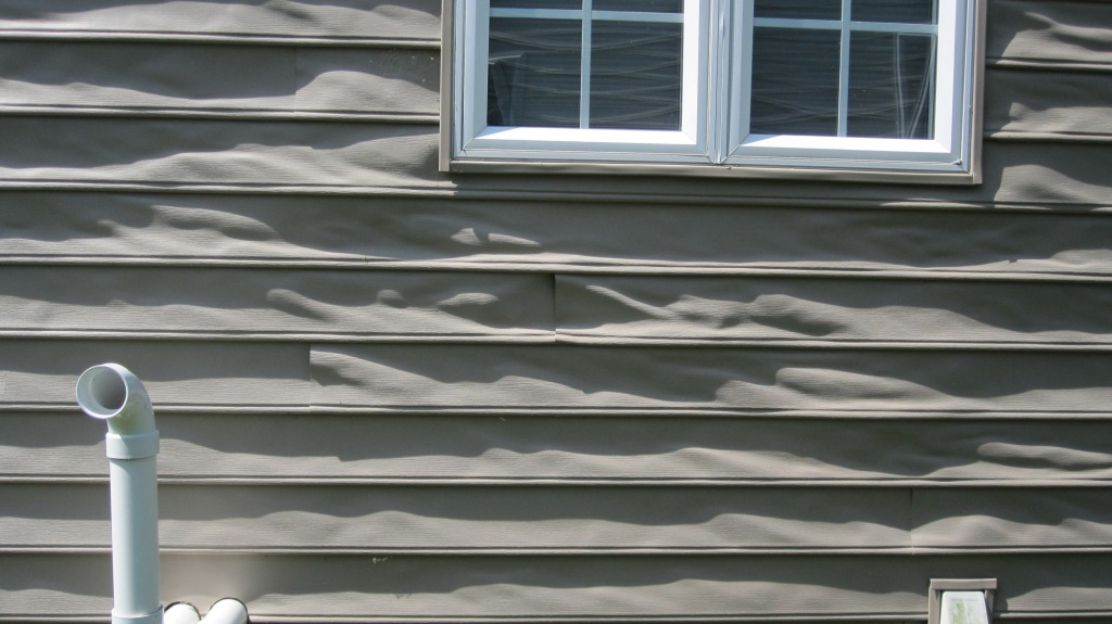 Melted vinyl siding flickr photo sharing for How big is a square of siding