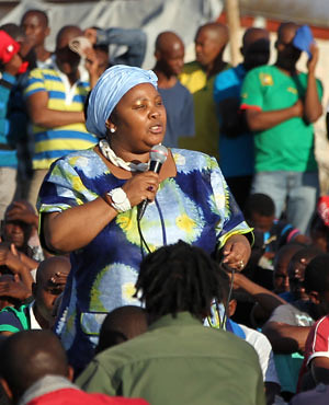South African Minister of Defense Nosiviwe Mapisa-Nqakula speaking to striking miners in Marikana on August 21, 2012. The government apologized for the killing of 34 miners the previous week. by Pan-African News Wire File Photos