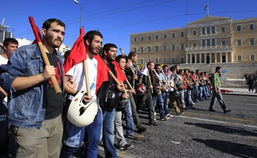Greek workers march through Athens amid the imposition by a right-wing government of further austerity measures. The world economic crisis of capitalism has rendered millions to unemployment and poverty. by Pan-African News Wire File Photos