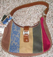 purple(0.0), rein(0.0), halter(0.0), maroon(0.0), horse tack(0.0), bag(1.0), pattern(1.0), shoulder bag(1.0), textile(1.0), brown(1.0), hobo bag(1.0), handbag(1.0),