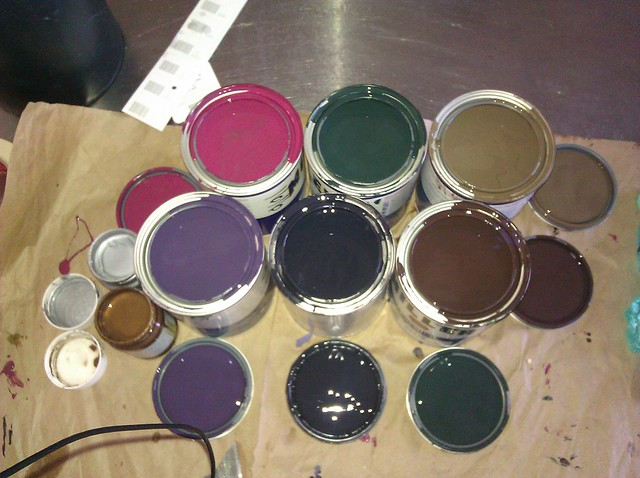 Six quarts of paint, crimson, purple, navy, burnt umber, dark forest green and mushroom brown, plus small pots of metallic bronze and metallic silver