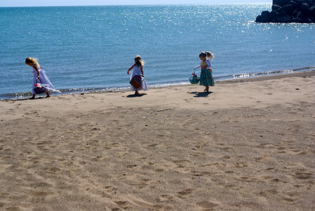 Girls playing on the sand