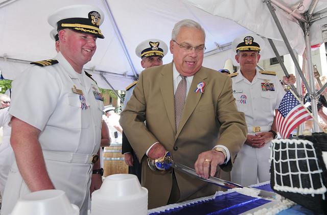 Thomas M. Menino, mayor of Boston, cuts a cake during the Boston Harborfest opening ceremony.