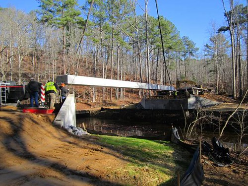 Setting the first of six box beams for the new Pine Glen Bridge (Forest Service photo, December 2011).