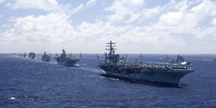 Ships participating in Rim of the Pacific (RIMPAC) exercise 2012 sail in formation in the waters around the Hawaiian islands. (U.S. Navy file photo)