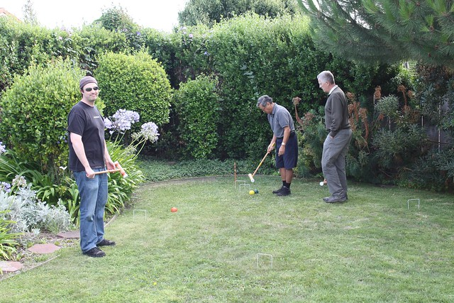 Guys playing croquet