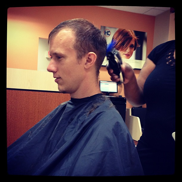 Watching my hubby get his haircut! He's so handsome!