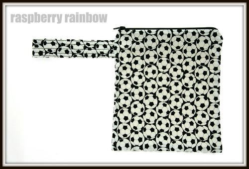 Footballs fabric zippered pouch.