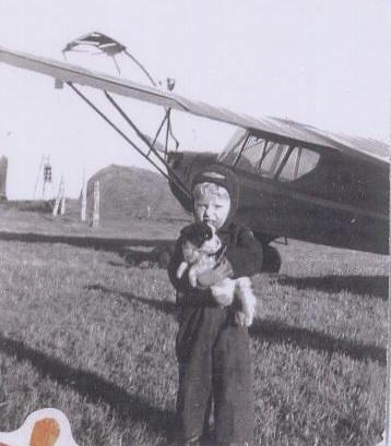 Uncle Tom in front of an airplane at the farm, 1947.