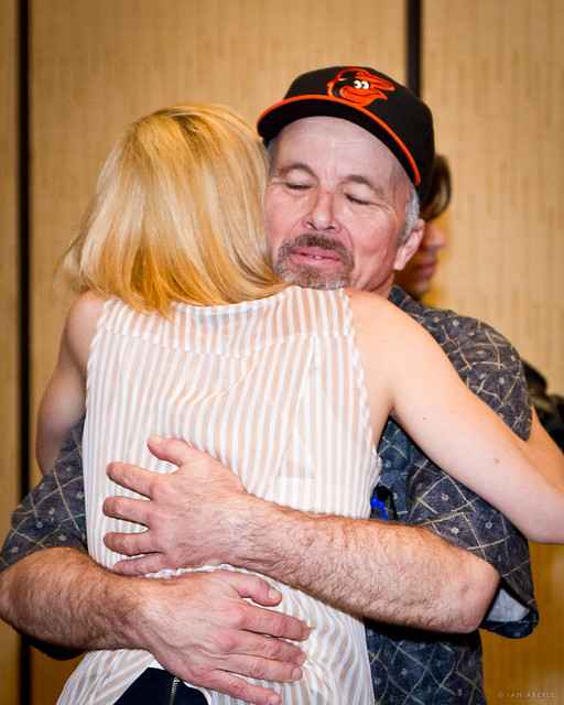 Marie Bollinger and Clint Howard embrace after the Huff screening.