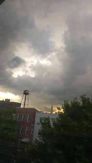 Sunset, storm clouds, water tower, Empire State Building.