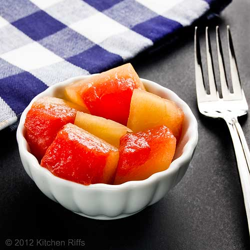 Pickled Watermelon Rind in White Dish with Napkin and Fork, Dark Background