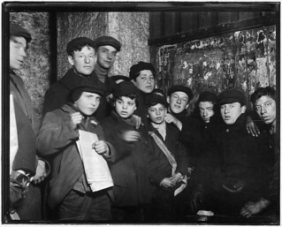 Newsies in cellar-room of a paper office in alley back of Main St. waiting for evening papers, 4 P.M. Conditions here vile. Rochester, N.Y, February 1910