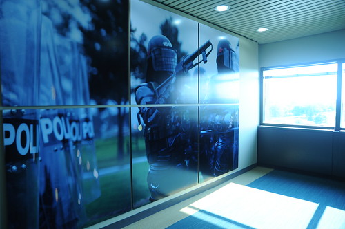 Police with riot shields, non-lethal rifle, hallway photos, Motorola Solutions, Schaumburg, Illinois, USA by Wonderlane