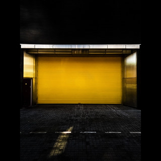 A Clean Bright Yellow Shutter Door on a Back Street Somewhere in Birmingham City Centre On a Lovely Warm Summer's Evening While  Working Away From Home (No Apologies for Lack of Punctuation)