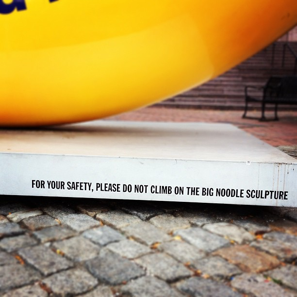 For your safety, please do not climb on the the big noodle statue.
