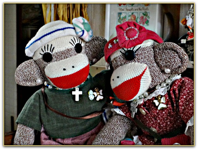 "Sockmonkeys, Kei and Miki, are chatting about when their next photos will be taken as ""Spring is in the Air""."
