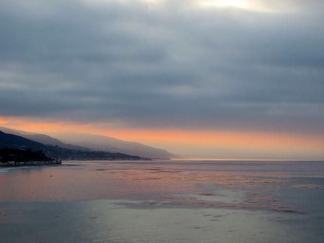 sun rises, clouds win