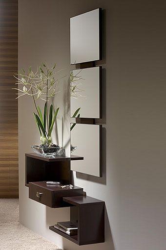 Mueble de entrada de diseño moderno, formado por espejo y repisa con cajón. ...
