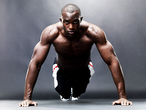 Bodybuilding - Healthy young guy doing push up exercise