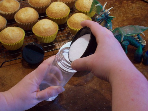 Pour Sugar into Container