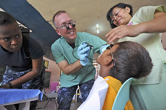 Lt. Cmdr. David Allen, center, examines a seven-year-old patient at Paaralang Elementary School in Samar, Philippines, during a medical civic action project (MEDCAP) as part of Pacific Partnership. (U.S. Navy photo by Mass Communication Specialist 2nd Class Roadell Hickman)