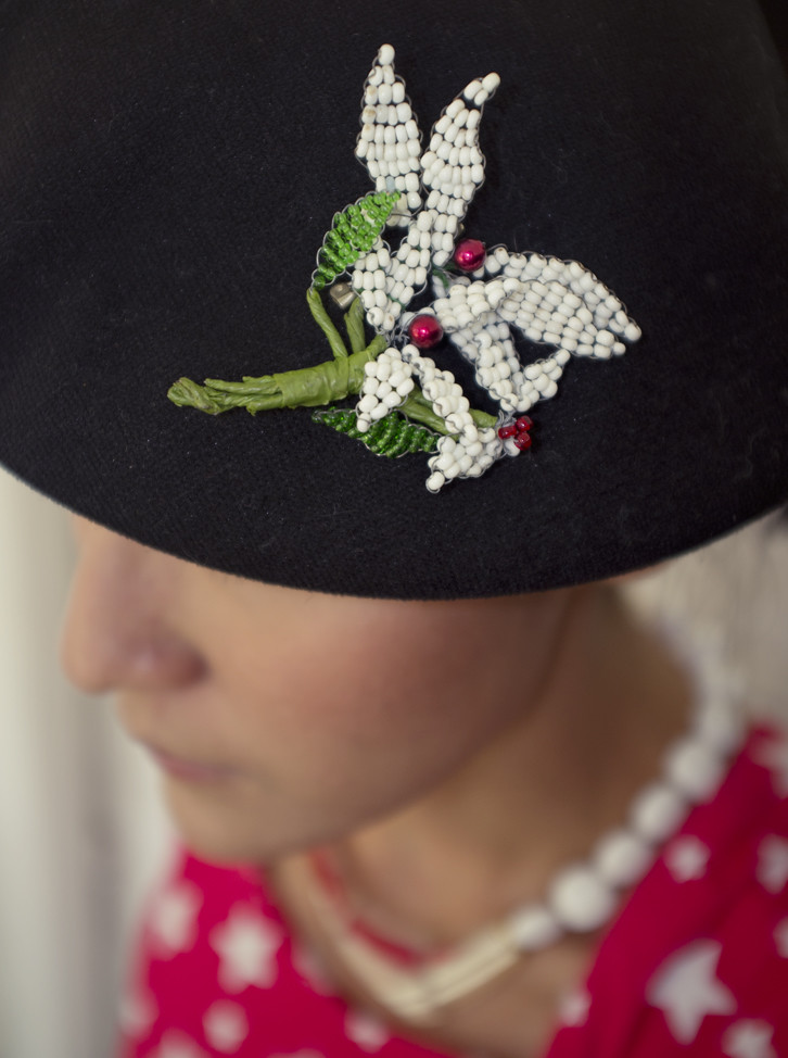 We have fun with our brooches, as you can see. Here, a 1960s white beaded leaf brooch stands out against a black beret.