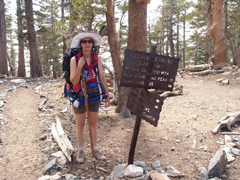 Vicki at the Dollar Lake Saddle Trail Junction sign