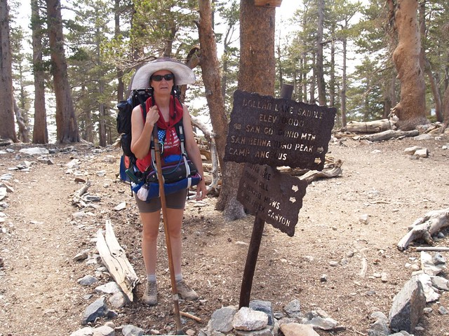 Vicki at the Dollar Lake Saddle Trail Junction sign