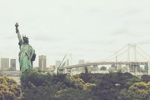 Replica of the Statue of Liberty, and the Rainbow Bridge, which looks like New York's Brooklyn Bridge in the futuristic Odaiba