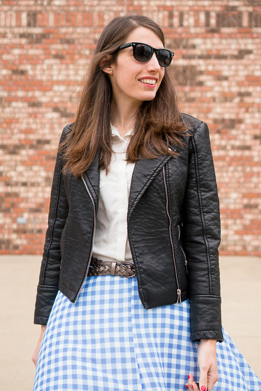 black leather jacket + blue and white gingham skirt + black quilted purse | Style On Target