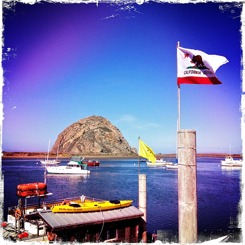 ocean california blue beach rock square boats harbor pacific wind bluesky flags smiley squareformat morrobay 1001nights iphone iphoneography iphoneonly 1001nightsmagiccity hipstamatic lucifervi kodotxgrizzled iphone4s