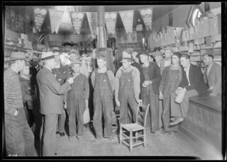 E. H. Elam, interviewer from the Personnel Division, TVA, conferring with residents of the neighborhood at Stiner's store, Union County, Tennessee, November 1933